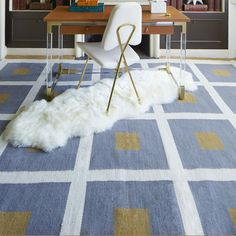 The right rug can open your space–pick one with a light hue for a dreamy feel.