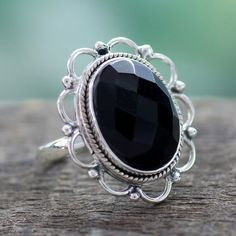 NOVICA Onyx and Sterling Silver Flower Ring from India ($43) ❤ liked on Polyvore featuring jewelry, rings, onyx, single stone, novica, flower jewellery, onyx jewelry, flower ring and novica rings