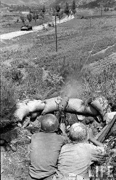 Korean War US M1917A1 30-caliber Machine Gun firing in the Dabudon