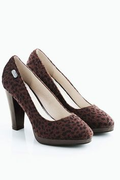 Classic court shoes, featuring a rounded almond toe, low cut vamp, leopard print to the faux horsehair main, platform to front, a slim rubber sole and a high block heel.