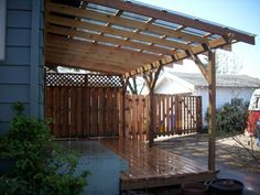 Cedar deck w/ polycarbonate patio cover and recycled gates | Deck Masters, llc - Portland, OR