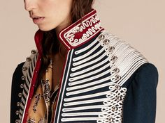 A highly crafted Burberry cavalry-style jacket adorned with hand-worked braided regalia sourced from a London embroidery atelier.