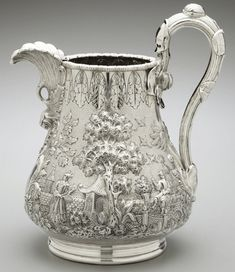 After starting out as a modest fancy goods retailer on lower Broadway, Charles Henry Tiffany established Tiffany, Young & Ellis in 1841 and began to manufacture silver pieces ten years later. This ornate water pitcher, circa 1850, decorated with an elaborate Chinese landscape, was one of the earliest silver objects Tiffany sold.