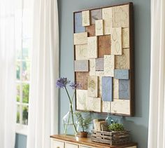 Perhaps create something like this using plaster of paris and botanicals from the yard. How to keep it light?