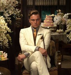 """What to wear: A white linen suit with a shirt and tie in contrasting colors. Make sure your hair makes a nice swoop, and carry a dainty walking stick. How to act: Fussy, but like you still love a party. Refer to everyone as """"old sport."""""""