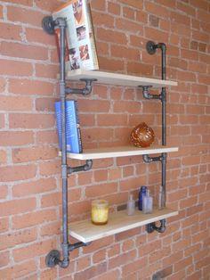 Industrial pipe wall mount shelf.