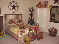 Hayden's room. LOVE the toy barrel! And the windmill.