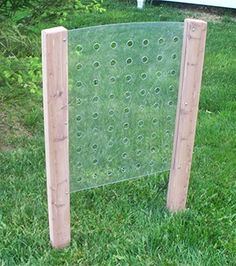 Bet this could be made pretty easily...Children can intertwine various materials through this outdoor Weaving Panel, such as ribbon, yarn and string. This unique piece of outdoor learning equipment allows children to use their imaginations to create an artistic design with the weaving materials.