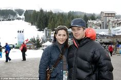 Twice as nice: The couple wore matching padded bomber jackets as they braced against the c...