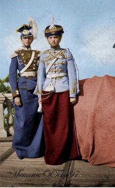 A beautifully colorized photo of Grand Duchess Olga Nikolaievna Romanov (Left) and Grand Duchess Tatiana Nikolaievna Romanov (Right) in the uniforms of their regiments.: In uniforms by MemoriesOfTime97