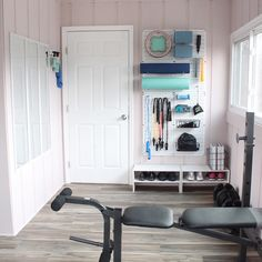 We're obsessing over the bright walls and white accents in this home gym. Which detail is your favorite? Gym and pic by @lelaburris #HomeGym #MudroomConversion #DIY Wall Storage, Wall Shelves, Peg Wall, Diy Home Gym, Bright Walls, Bright Homes, Diy Home Decor Projects, Home Organization, Organizing Ideas