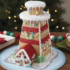gingerbread house Wilton Build-it-Yourself Gingerbread Lighthouse Decorating Kit. Add a nautical look to your holiday décor with this impressive gingerbread Lighthouse. The kit contains everything you need for building and decorating including pre-baked gingerbread Lighthouse pieces, 3 types of candies, white and Red ready-to-use icings, colorful presentation board, 2 decorating bags, 2 tips, cardboard base plus a helpful instruction sheet. #lighthouse #christmas #gingerbreadhouse Best Gingerbread House Kit, Gingerbread Cookie Mix, Cardboard Gingerbread House, Cool Gingerbread Houses, Gingerbread Men, Christmas Desserts, Holiday Treats, Christmas Baking, Christmas Traditions