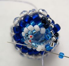 circular peyote stitch starting with four beads | 59. Round 7 (Change of bead size) Peyote spiral stitch the first 2 ...