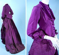 Visiting dress, French, ca. 1870s. Magenta/purple silk in 2 pieces. Fitted bodice trimmed in velvet with thread-covered buttons & decorative ribbon work at cuffs. Lined in silk twill. Heavy skirt with swagged apron of silk velvet, trimmed in long fly fringe, box pleats at hem and long tails of  velvet in back. Carolyn Forbes Textiles/ebay