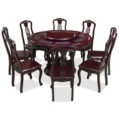 54in Round Rosewood Mother Pearl Dining Table Set with 8 Chairs.  Intricately carved in triple coins motif, symbolizing prosperity and wealth in Chinese culture. Completely handmade in solid rosewood by artisans in China. One removable lazy Susan is included for your convenience. Beautiful pearl inlays adorn the table top and chairs. Dark cherry finish. Oriental Rosewood dining set.