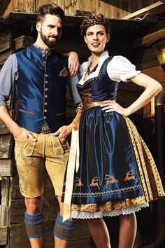 These are traditional German/Oktoberfest attire: Liederhosen for men, and Dirndls for women. Many people at Oktoberfests today will dress up in this type of clothing since it was such a valued tradition in the past.