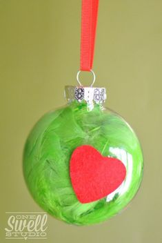 Grinch Ornament – Simple DIY project that's great for little hands!  A Very Grinchy Christmas (Party On a Budget) by One Swell Studio