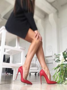 Red pumps and great legs