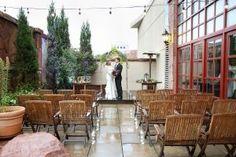 Outdoor Patio Ceremony with Bride & Groom. Weddings at The Warwick Denver Hotel in downtown Denver, Colorado.