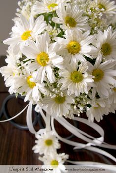 Daisy wedding Bouquet---hot glue a silk daisy head onto the end of the ribbons