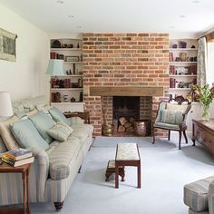 Traditional living room with brick chimney | Living room decorating | 25 Beautiful Homes |id paint fireplace white