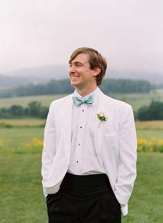 Preppy groom attire, light blue bowtie, white jacket, cream floral bout // Elisa Bricker