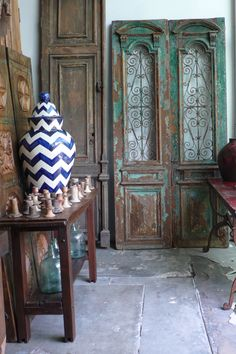 Antique doors and chevron patterned pottery at our warehouse in Newbury Park California