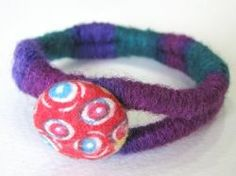 How to make a yarn wrapped bracelet. By So Crafty contributor purpledot. http://crafting.squidoo.com/how-to-make-a-yarn-wrapped-bracelet
