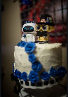 Photos of my White And Nerdy Wedding, wedding cake, toppers designed by the Bride. Photos by facebook.com/ShotByJonny.