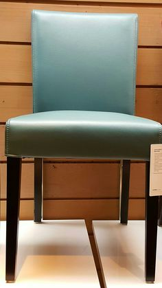 Crate & Barrel - - prefer real solid wood. Like leather chair for kitchen table
