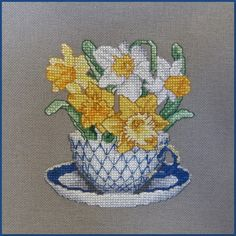 Teacup flowers, awesome stitching and detail.