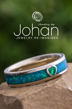 Jewelry by Johan's wedding bands are handmade with unique materials, like synthetic opal and birthstones. #JewelrybyJohan Unique Wedding Bands, Emerald Gemstone, Birthstones, Cuff Bracelets, Opal, Engagement Rings, Handmade, Jewelry, Dresses