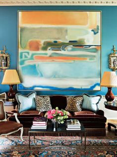 Miles Redd. Love the royal blue walls, traditional rug and stunning abstract art.