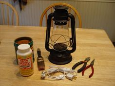 Well, I thought I would try and do my first tutorial of this  Primitive Rusty Electric Lantern Light   I found this black lantern at Walmart...