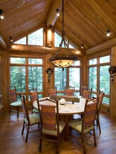 Open log cabin dining room, Bill Michels Architect