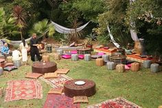 Moroccan rugs as ground cover for circus picnic wedding. @christadicksonn