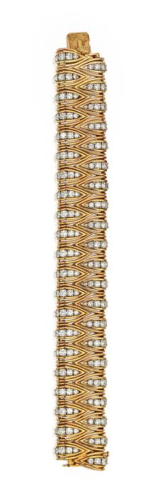 18 KARAT TWO-COLOR GOLD AND DIAMOND BRACELET, CARTIER, PARIS.  Of openwork design, set at intervals with round diamonds weighing approximately 15.10 carats, gross weight approximately 61 dwts, length 7¼ inches, signed Cartier Inc., Made in France, numbered 484, with French assay and workshop marks. With signed box.