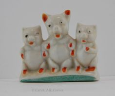 SOLD - Small glazed porcelain ceramic figurine features three standing pigs with cold paint accents.  Marked Japan on the bottom in black, unknown manufacturer.