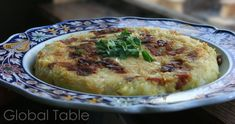 """Andorran Trinxat (potatoes, cabbage, and bacon) Serves 4 Trinxat is an Andorranspecialty. Potatoes, cabbage, and bacon get fried together in a hash """"pancake.""""Garnish with minced parsl…"""