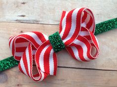A personal favorite from my Etsy shop https://www.etsy.com/listing/211883144/red-white-striped-bow-on-green-glitter