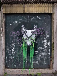 """""""The Host"""" a new street art piece by French artist Ludo on the streets of Paris, France."""