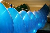 Just use a needle and thread to hang up balloons for any party! Neat idea