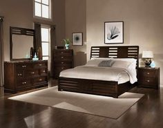 best paint colors for master bedroom_dark wooden furniture set_white bedsheet and pillows_white rug_broen laminated floor_brown curtain