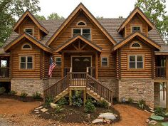 Blog Cabin: Rustic Log Cabins: A luxury lakeside cabin built on Watts Bar Lake in east Tennessee, DIY Network's second Blog Cabin featured a massive wraparound porch, a great room with vaulted ceilings and loft, a stone patio, fire pit and an outdoor pizza kitchen.  From DIYnetwork.com