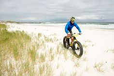 Weskus Fat Bike Adventure: Once safely down the monstrous dune, we got out first taste of open beach. It's a wonderful feeling cruising along with riders scattered along an endless beach with nothing but sea, sand, and blossoming flowers in sight.