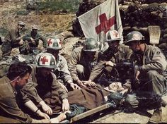 1945  US soldiers and medics of the 10th Mountain Division tend to a German POW, Bologna, Italy