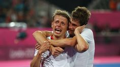 Benjamin Wess of Germany is comforted by a team mate while celebrating winning the gold medal against Netherlands in the Men's Hockey gold medal match on Day 15 of the London 2012 Olympic Games at Riverbank Arena