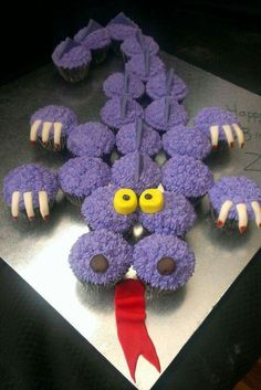 DRAGON CUPCAKE CAKE...these is SO adorable & easy to make! Love it!! Featured on our Best Pull-Apart Cake Ideas.  http://kitchenfunwithmy3sons.com/2016/04/best-cupcake-cake-ideas.html/
