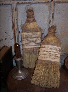 """Aged early brooms...dressed up in   """"layers""""....cheesecloth, fabric, twine!  Sooo  cute!!"""
