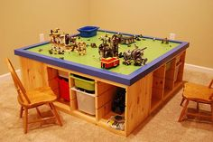 Enchanting Wooden Lego Storage Unit Workstation With Colorful Plastic Trundle Bin Wooden Chairs Green Wood Countertop Blue Frame In Kids Room With White Carpet: Remarkable Lego Storage Units ~ mutni.com Architecture Inspiration